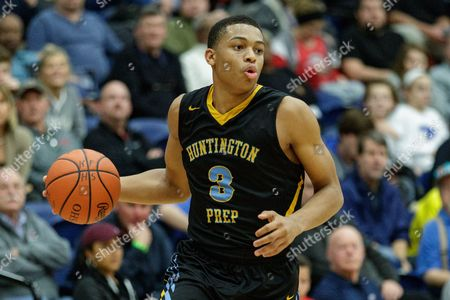 Stock Photo of th, Huntington Prep Fighting Irish Keldon Johnson (3) drives into the land during basketball game action between the Wayne Warriors and the Huntington Prep Fighting Irish in the Premier Health Flyin' to the Hoop Invitational at Trent Arena, Kettering, OH