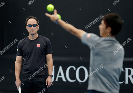 Japan's Kei Nishikori is watched by coach Michael Chang during a practice session ahead of the the Australian Open tennis championships in Melbourne, Australia