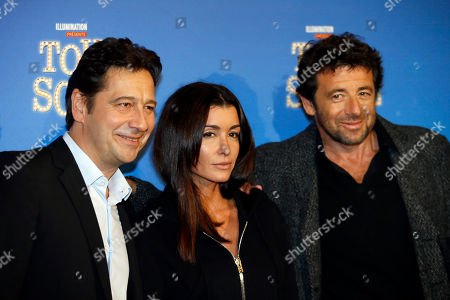 """Laurent Gerra, Jenifer Bartoli and Patrick Bruel, from left to right, pose during a photo call for the french premiere of """"Tous en Scene"""" at Le Grand Rex in Paris, France"""
