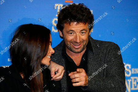 """Jenifer Bartoli, left and Patrick Bruel pose during a photo call for the french premiere of """"Tous en Scene"""" at Le Grand Rex in Paris, France"""
