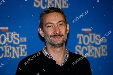 "Actor Vincent Desagnat poses during a photo call for the french premiere of ""Tous en Scene"" at Le Grand Rex in Paris, France"