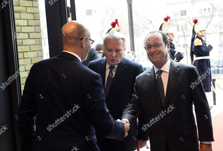 French President Francois Hollande (R) shakes hands with State Secretary for European Affairs Harlem Desir (L) as he arrives with French Minister of Foreign Affairs Jean-Marc Ayrault for the Mideast peace conference in Paris, France, 15 January 2017. Foreign ministers and representatives from around 70 countries are seeking to revive the moribund Israeli-Palestinian peace process, which could be dealt a further blow if Trump implements a campaign pledge to recognise Jerusalem as Israel's capital.