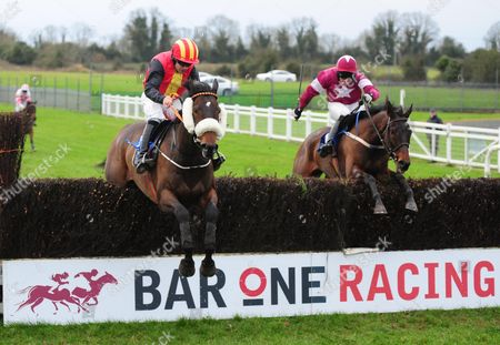 Stock Picture of Fairyhouse LAID BACK LUKE & Robert Colgan (left) jump the last to win the Irish Stallion Farms EBF Novice Steeplechase from CATALAUNIAN FIELDS & Barry John Foley (right)