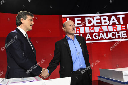 Candidate for the left-wing party primaries ahead of the 2017 presidential election, former Economy minister Arnaud Montebourg (R) shakes hands with President of the Democratic Front (Front Democrate) Jean-Luc Bennahmias as they participate in the second televised debate in Paris, France, 15 January 2017. France's seven left-wing presidential candidates hold their second televised debate before the first round of their primary on January 22.