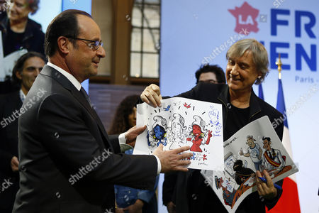 French President Francois Hollande (L) receives a cartoon from French cartoonist Plantu (R) of the 'Cartooning for Peace' association during a visit at a forum entitled 'France s'engage' dedicated to associations for social and solidarity projects of education, employment, culture, environment and sports in Paris, France, 15 January, 2017.