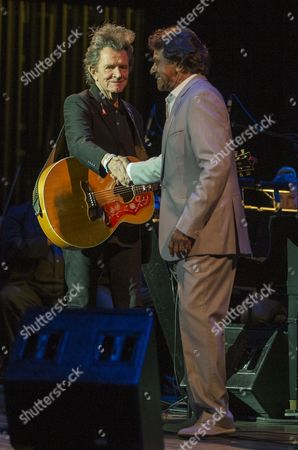 Johnny Mathis shakes the hand of Gary Mule Deer during their Voices of Romance Tour at the Lakeland Center in Lakeland, Florida
