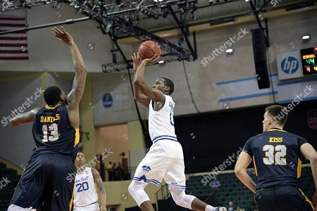 Seton Hall guard Khadeen Carrington (0) goes up for a shot between Quinnipiac forward Chaise Daniels (13) and guard Peter Kiss (32) during the first half of an NCAA college basketball game at the AdvoCare Invitational tournament in Lake Buena Vista, Fla