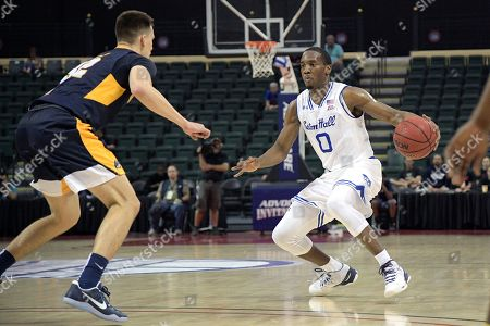 Seton Hall guard Khadeen Carrington (0) sets up for a shot in front of Quinnipiac guard Peter Kiss (32) during the first half of an NCAA college basketball game at the AdvoCare Invitational tournament in Lake Buena Vista, Fla
