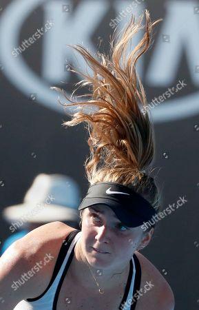 Ukraine's Elina Svitlonia's hair flies up as she serves to Kazakstan's Galina Voskoboeva during their first round match at the Australian Open tennis championships in Melbourne, Australia