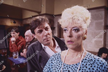 Stock Image of Nigel Gregory (as Frank Mills) and Julie Goodyear (as Bet Lynch)