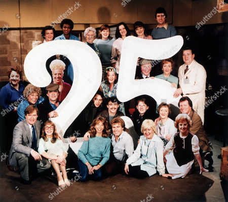 Regular cast members celebrate the programme's 25th anniversary. Front row: William Roache (as Ken Barlow), Anne Kirkbride (as Deirdre Barlow), Helen Worth (as Gail Tilsley), Christopher Quinten (as Brian Tilsley), Lynne Perrie (as Ivy Tilsley) and Barbara Knox (as Rita Fairclough), Second row: Elizabeth Dawn (as Vera Duckworth), William Tarmey (as Jack Duckworth), Nigel Pivaro (as Terry Duckworth), Michael Le Vell (as Kevin Webster), Kevin Kennedy (as Curly Watts), Thelma Barlow (as Mavis Riley) and Johnny Briggs (as Mike Baldwin) Third row: Betty Driver (as Betty Turpin), Julie Goodyear (as Bet Lynch), Jean Alexander (as Hilda Ogden), Bill Waddington (as Percy Sugden), Eileen Derbyshire (as Emily Bishop) and Bryan Mosley (as Alf Roberts) Back Row: Helene Palmer (as Ida Clough), Lisa Lewis (as Shirley Armitage), Jill Summers (as Phyllis Pearce) Jane Hazlegrove (as Sue Clayton), Caroline O'Neill (as Andrea Clayton), Susan Brown (as Connie Clayton) and Johnny Leeze (as Harry Clayton)