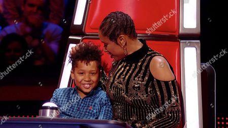 Jennifer Hudson brings her son David Daniel Otunga Jr. onto the stage