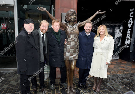 A statue of Cilla Black is unveiled outside the Cavern Club by her sons Ben Willis, Robert Willis and Jack Willis