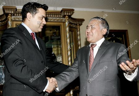 British International Development Minister Shahid Malik (l) is Welcomed by Chairman of Muhammadiyah Indonesia's Second Largest Muslim Organization Din Syamsuddin (r) Prior to Their Meeting in Jakarta 24 June 2008 Malik is in Jakarta For Two Days Official Visit to Meets Some Indonesian Government and Religious Leaders to Discuss Cooperation On Development Issues