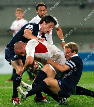 Scotland's Colin Gregor (r) and Johnny Weston (l) Tackling England's Anthony Roques During a Match in the Rugby Sevens Tournament in Singapore On Saturday 16 April 2005 England Beat Scotland 21-5
