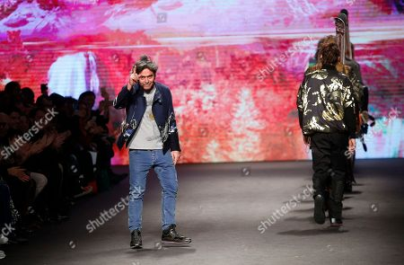Italian fashion designer Kean Etro ackowledges the applause at the end of his Etro men's Fall-Winter 2017-2018 collection, part of the Milan Fashion Week, unveiled in Milan, Italy
