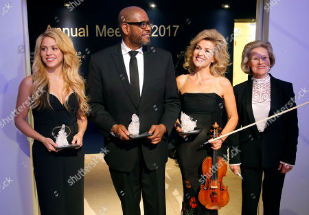 Stock Image of From left, 'Crystal Award' winners Colombian singer Shakira, U.S. Actor Forest Whitaker, German violinist Anne-Sophie Mutter and presenter Hilde Schwab, left, wife of WEF founder Klaus Schwab, pose for the media after an award ceremony on the eve of to the World Economic Forum in Davos, Switzerland