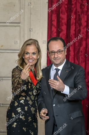 French President Francois Hollande (R) and US ambassador to France Jane Hartley (L) gesture after she was awarded of the Legion of Honour (Legion d'Honneur) by the French president at the Elysee Presidential Palace in Paris, France, 16 January 2017.