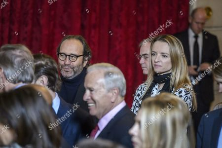 French communication group Iliad CEO Xavier Niel  and his compaign Delphine Arnault attend at the ceremony of  awarded of the Legion of Honour (Legion d'Honneur) by French President Francois Hollande (not pictured) to the US ambassador to France Jane Hartley (not pictured) at the Elysee Presidential Palace in Paris, France, 16 January 2017.