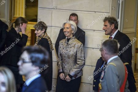 Stock Photo of International Monetary Fund (IMF) Managing Director Christine Lagarde (C) attends at the ceremony of  awarded of the Legion of Honour (Legion d'Honneur) by French President Francois Hollande (not pictured) to the US ambassador to France Jane Hartley (not pictured) at the Elysee Presidential Palace in Paris, France, 16 January 2017.