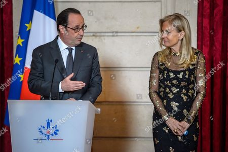 Stock Picture of French President Francois Hollande (R) awards the Legion of Honour (Legion d'Honneur) to US ambassador to France Jane Hartley (L) at the Elysee Presidential Palace in Paris, France, 16 January 2017.