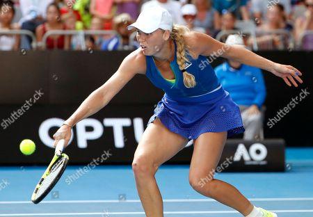 Denmark's Caroline Wozniacki reaches out for a shot to Australia's Arina Rodionova during their first round match at the Australian Open tennis championships in Melbourne, Australia