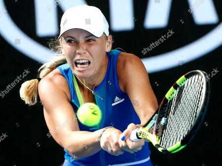Denmark's Caroline Wozniacki makes a backhand return to Australia's Arina Rodionova during their first round match at the Australian Open tennis championships in Melbourne, Australia