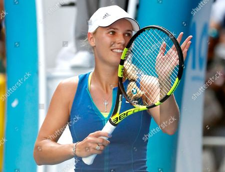 Denmark's Caroline Wozniacki celebrates after defeating Australia's Arina Rodionova during their first round match at the Australian Open tennis championships in Melbourne, Australia