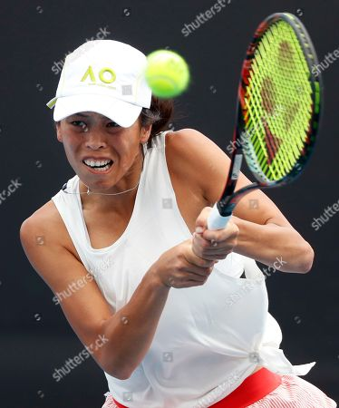 Taiwan's Hsieh Su-Wei makes a backhand return to Italy's Karin Knapp during their first round match at the Australian Open tennis championships in Melbourne, Australia