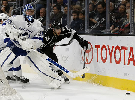 Ben Bishop, Nic Dowd Tampa Bay Lightning goalie Ben Bishop (30) sends the puck away from Los Angeles Kings center Nic Dowd (26) during the second period of an NHL hockey game in Los Angeles