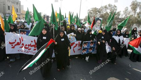 Bahrainis Women March On the Outskirts of the Capital Manama During the Annual International Quds (jerusalem) Day in Manama Bahrain 05 October 2007 Thousands of Bahrainis Mainly Shiites Took to the Streets Answering the Annual Call by the Late Founder of the Iranian Islamic Republic Grand Ayatollah Seyyed Ruhollah Musavi Khomeini Demonstrators Marched Through Mainly Shiite Villages Chanting Death to America Death to Israel and Israel Must Be Wiped Off the Map Hundreds of Women in Black Chador Also Took Part in the March where Larger Posters of Ayatollah Khomeini Were Raised Alongside Pictures of Irans Present Supreme Leader Seyyed Ali Khamenei and the General Secretary of the Lebanese Hezbollah Seyyed Hassan Nasrallah