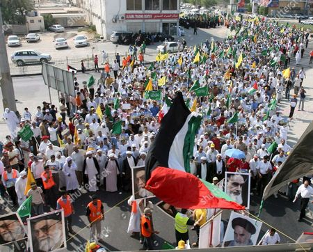Bahrainis March On the Outskirts of the Capital Manama During the Annual International Quds (jerusalem) Day in Manama Bahrain 05 October 2007 Thousands of Bahrainis Mainly Shiites Took to the Streets Answering the Annual Call by the Late Founder of the Iranian Islamic Republic Grand Ayatollah Seyyed Ruhollah Musavi Khomeini Demonstrators Marched Through Mainly Shiite Villages Chanting Death to America Death to Israel and Israel Must Be Wiped Off the Map Hundreds of Women in Black Chador Also Took Part in the March where Larger Posters of Ayatollah Khomeini Were Raised Alongside Pictures of Irans Present Supreme Leader Seyyed Ali Khamenei and the General Secretary of the Lebanese Hezbollah Seyyed Hassan Nasrallah