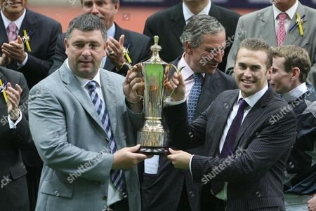 Kevin Bailey (l) and Philip Booth Hold the Trophy After Their Horse Presvis Won the Qeii Cup at the Shatin Race Track During the Horse Races in Hong Kong China 26 April 2009