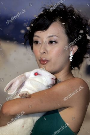 Chinese Actress Sun Li (betty Sun) Poses with a Rabbit On a Set Decorated with Fake Snow For an Anti-fur Advertisement For People For the Ethical Treatment of Animals (peta) Asia Pacific in Beijing China 25 July 2007 Members of the Press Were Given a Preview of the Advertisement That Has the Tagline 'Don't Be Cold-hearted - No Fur' China is the World's Leading Exporter of Fur and Millions of Cats and Dogs Are Killed in Inhumane Ways According to Peta
