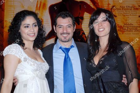 (r-l) Lebanese Actress and Director Nadin Labky Lebanese Actor Adel Karam and Lebanese Actress Yasmin Almasry Pose For Photographers During the Movie Premiere of 'Sokkar Banat' in Cairo Egypt 18 February 2008