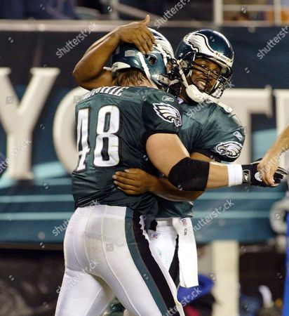 Stock Photo of Jon Ritchie (l) and Quarterback Donovan Mcnabb (r) of the Philadelphia Eagles Celebrate Their Game Winning Touchdown in the 4th Quarter of Their Game with the New York Jets Sunday 26 October 2003 at Lincoln Financial Field in Philadelphia the Eagles Won 24-17