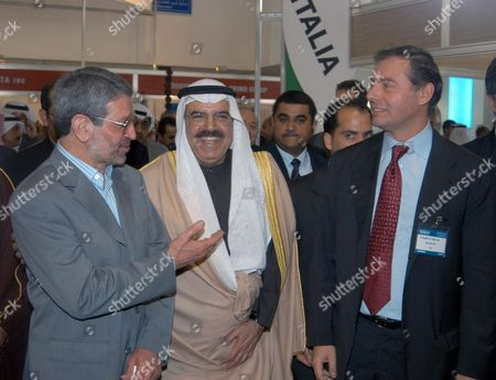 Kuwaiti Minister of Commerce Abdullah Al-taweel (c) Iraqi Minister For Housing and Reconstruction Baqer Bayan Al-zubaidi (l) and Itali Minister For Foreign Trade Adolfo Urso (r) Attend the Rebuild Iraq 2004 Exhibition at the Kuwaiti Intrnational Fair Grounds 19 Jan 2004 the Exhibition is the Most Significant Networking Opportunity Being Offered to Companies and Businessmen Looking For a Role in the Iraq Re-building Program and the Biggest Reconstruction Effort Ever Attempted Since World War 2 the Us Administration Has Already Budgeted Over 18 Billion Dollars (14 5 Billion Euros) For the Plan