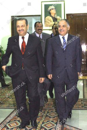 Libya's New Prime Minister Baghdadi Al-al-mahmoudi (r) Walks with Out-going Reform Minded Prime Minister Shukri Ghanem (l) in Tripoli Thursday 09 March 2006 in What is Seen As a Major Cabinet Reshuffle Al-al-mahmoudi Said He Would Continue to Implement the Economic Policy of His Predecessor Libya's Top Legislative and Executive Body On Sunday Named Al-al-mahmoudi As Its New Prime Minister Libya Has Over the Past Year Opened Up Diplomatic and Economic with the West and the United States