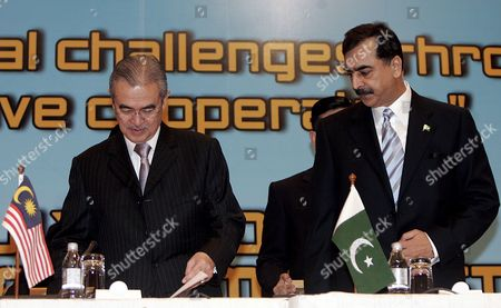Malaysian Prime Minister Abdullah Ahmad Badawi (l) and Pakistan Prime Minister Syed Yousuf Raza Gillani (r) Arrives at a Joint Press Conference After the End of the Summit Meeting of the 25th Session of Group of Eight Islamic Developing Countries (d-8) Summit in Kuala Lumpur Malaysia 8 July 2008 the D-8 is Made Up of Bangladesh Egypt Indonesia Iran Malaysia Nigeria Pakistan and Turkey It Was Established in 1997 As a Forum to Enhance Cooperation in Various Areas to Improve the Economic Status of Member States