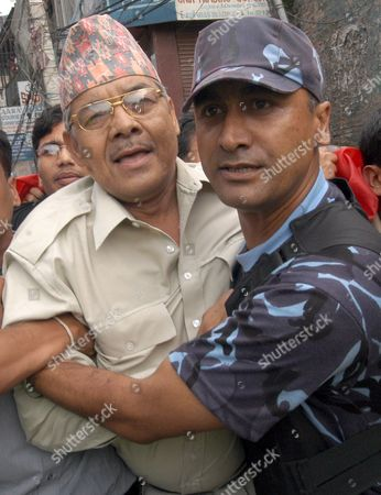 Nepalese Riot Police Arrest Bamdev Gautam (l) Central Leader of the Communist Party of Nepal - United Marxist Leninist During a Freedom Demonstration at Bagbazar in Kathmandu On Sunday 13 September 2005 Nepal's Seven Political Parties Alliance Continuously Protests Against King Gyanendra's Take-over and Demand the Re- Establishment of Democracy More Than 100 Leaders and Cadres Were Arrested and Dozens Injured During Today's Demonstration