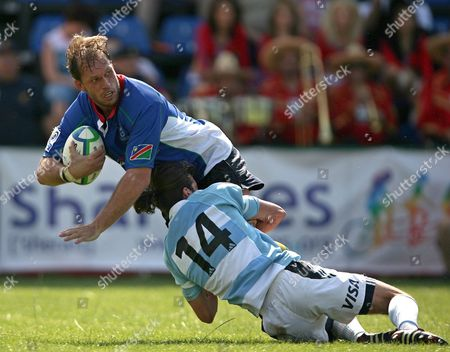 Stock Picture of Namibia's Heino Senekal (l) is Tackled by Argentina A's Roman Miralles (r) During Their Rugby Union Game Counting For Irb Nations Cup in Bucharest 10 June 2007