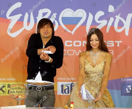 Russian Singer Dima Bilan Holds a Piece of Paper with the Name of a Country-participant During a Draw For Eurovision Song Contest 2009 in Moscow Russia 16 March 2009 After Russian Dima Bilan's Last Year Victory Russia Will Host Eurovision 2009 in May