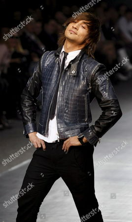 Winner of the Eurovision Song Contest 2008 Russian Singer Dima Bilan Displays a Creation by Russian Designer Ilya Shiyan at the Fashion Week in Moscow Russia 23 March 2009 the Fashion Week Runs Until 27 March