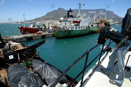 Crew Member Joel Capolongo From the Usa Looks Over the Deck of the Canadian Flagged Vessel Farley Mowat Detained by South African Authorities in Cape Town Harbour Thursday 26 January 2006 the Canadian Registered Ship Owned by the Activist Sea Shepherd Conservation Society Was Detained When It Docked Two Days Ago After Returning From the Antarctic On a Mission of Detering Japanese Whalers