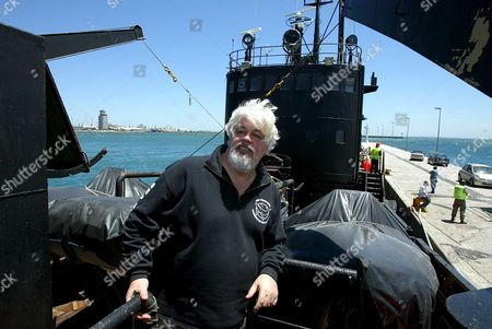 Epa00623936 Captain Paul Watson From Canada Stands On the Dock Next to the Canadian Flagged Vessel Farley Mowat Detained by South African Authorities in Cape Town Harbour Thursday 26 January 2006 the Canadian Registered Ship Owned by the Activist Sea Shepherd Conservation Society Was Detained When It Docked Two Days Ago After Returning From the Antarctic On a Mission of Detering Japanese Whalers