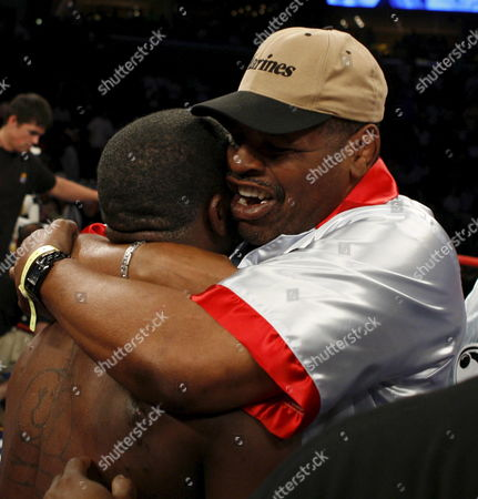 Cory Spinks Gets a Hug From His Father Former Heavyweight Champion Leon Spinks After the Wbc & Wbo World Middleweight Championship Against Jermain Taylor at the Fedex Forum in Memphis Tennessee 19 May 2007 Taylor Held Onto His Titles by Split Decision