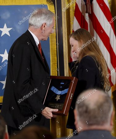 Maureen Murphy (r) with Her Husband Daniel Murphy (l) Look at the Medal of Honor Posthumously Awarded to Their Son Navy Seal Lieutenant Michael Murphy During a Ceremony in the East Room of the White House in Washington D C Usa 22 October 2007 Lieutenant Murphy Was Killed in Action in Afghanistan