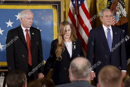 Us President George W Bush Holds Hands with Maureen Murphy and Her Husband Daniel Murphy the Parents of Navy Seal Lieutenant Michael Murphy After Posthumously Awarding Him the Medal of Honor During a Ceremony in the East Room of the White House in Washington D C Usa 22 October 2007 Lieutenant Murphy Was Killed in Action in Afghanistan