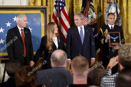 U S President George W Bush Holds Hands with Maureen Murphy and Her Husband Daniel Murphy the Parents of Navy Seal Lieutenant Michael Murphy After Posthumously Awarding Him the Medal of Honor During a Ceremony in the East Room of the White House in Washington D C Usa 22 October 2007 Lieutenant Murphy Was Killed in Action in Afghanistan