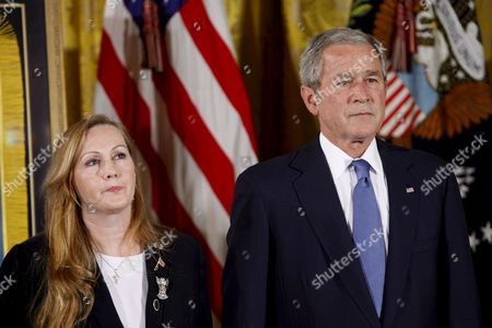 Us President George W Bush with Maureen Murphy the Mother of Navy Seal Lieutenant Michael Murphy After Posthumously Awarding Him the Medal of Honor During a Ceremony in the East Room of the White House in Washington D C Usa 22 October 2007 Lieutenant Murphy Was Killed in Action in Afghanistan